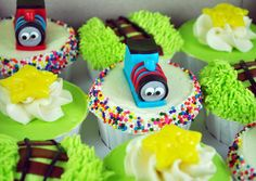 There's something very cute about these simplified versions of Thomas and James.  But what I really like is the cupcake with the track running through the grass behind Thomas.