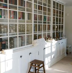 Glass doors on bookshelves help preventing dust, good for your nose.