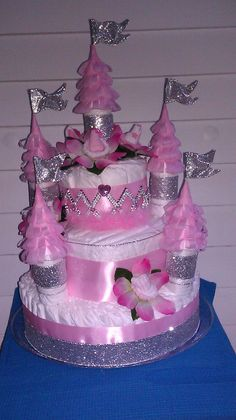The most awesome diaper cake castle EVER.I made this for my sister last summer. It had over 100 diapers- it was HUGE.