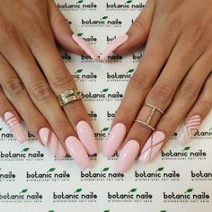 [NAILS: Love this soft pink on brown skin.  Simple design works well w/ this shape and color.]