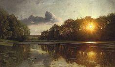 File:Peder Mønsted - Sunset over a forest lake.jpg