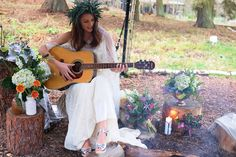 Top tip for an outdoor wedding campfire - provide an acoustic guitar for a late night singalong! ;)    Vintage style lace wedding dress by Rolling in Roses, silver clogs by Lotts from Stockholm.  Shot from our Scandi Boho Colourful Themed Styled Shoot in York (as featured on Bespoke Bride).   Kook Events: Yorkshire Wedding Planner and Wedding Stylist.
