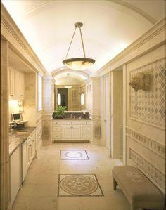 Husband's bath with tumbled limestone floor and walls.