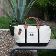 This hand-painted monogramed canvas bag is perfect for the gym, a quick beach excursion, a wedding, or overnight duffle bag for those not so quick excursions. **LYLAGRACEDESIGN.ETSY.COM**