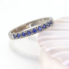 Blue Sapphire Half Eternity Ring, handcrafted by Lilia Nash in 18ct recycled gold or platinum. Price from £1,100.