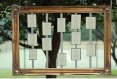 also cute   Picture frame wedding table plan