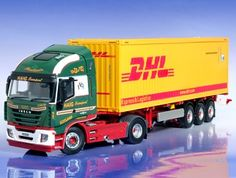This Iveco Stralis with DHL Container (David Haig Transport) Diecast Model Lorry is Green and features working wheels and also opening trailer doors. It is made by Universal Hobbies and is 1:50 scale (approx. 35cm / 13.8in long).  ...