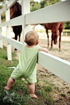 Precious Child - 9 months, walking, fence, horses... enough said