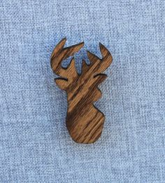 Deer magnet hand cut on a scroll saw from 1/4 red oak. The wood shapes are then sanded smooth. They are then finished with tinted danish oil to seal in their beauty. Finally, small neodymium rare earth magnets are inset into the back. These magnets are super strong and will easily hold any paper or photo to your refrigerator.   The deer measures approximately 2 by 3.75  Due to the nature of wood grain and the hand finish each magnet is slightly different. You may not receive the exact ones…