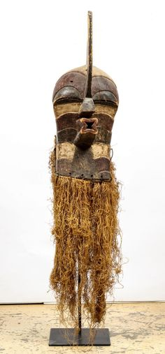 """Songye Kifwebe Mask. DRC, Africa. Carved wood, fiber, with stand. Size: 53"""" x 10.5"""" x 26"""" (135 x 27 x 66 cm"""