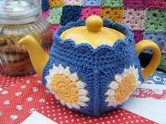 This cute DIY Crochet tea-cozy will make your guests envious. That is a must-have accessory in your kitchen collection. The custard yellow simple flowers along with extended white petals are beautifully paired with Dark blue yarn with rounded edges on the lid.