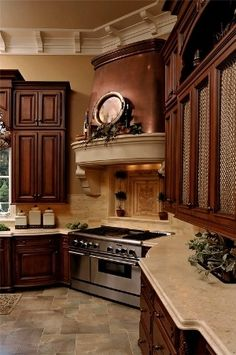 What about having the oven,stove top and hood in that unused corner of the kitchen?? And make it a designers dream kitchen by using beautiful fabric inside of side cabinets.  Fabulous old European ideas made new again. Kitchen space organization