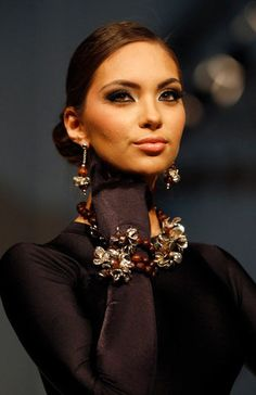 A model wears a creation by Peru's ILARIA during the second edition of Lima Fashion Week in Lima, Peru, Tuesday, April 24, 2012. (AP Photo/Martin Mejia)