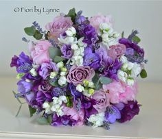Pink peonies, purple Sweet peas, lavender, stocks, lisianthus and freesia make a wonderful early summer bouquet.