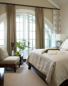 Bedroom - beautiful arched door - neutral color palette - beautiful room | via Andrea Strauttmansdorff Photographer
