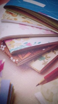 Make note book covers from material strips. Sew them together using the sewing machine - rustic and funky! Could twist the strips, add labels, buttons, photos etc to personalise