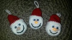 Crochet snowman ornaments around battery operated tea lights
