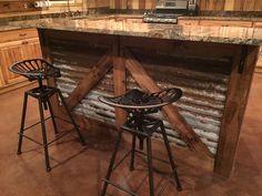 Rustic kitchen island. Barn style island. Tractor seat bar stools.