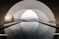 In Soprabolzano, Italy, the rooftop infinity pool at the Gloriette Guesthouse by. - In Soprabolzano, Italy, the rooftop infinity pool at the Gloriette Guesthouse by NOA* Network of Ar - Water Architecture, Futuristic Architecture, Architecture Photo, Amazing Architecture, Architecture Interiors, Sustainable Architecture, Parametric Architecture, Photo D'architecture, Infinity Pool