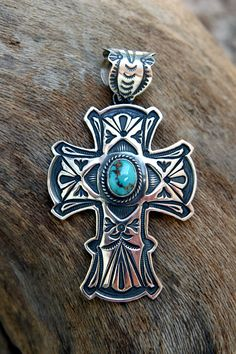 The famous Pilot Mountain Turquoise Mine in Western Nevada produced this lovely piece of turquoise set in hand-stamped sterling silver by a Navajo Indian artist.
