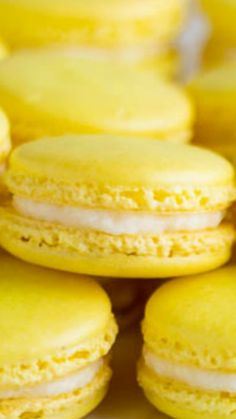 Lemon French Macarons ~ Perfect spring-flavored confections with zesty lemon buttercream, plus video tutorial on how to fold the batter.