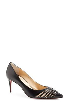 The ladylike shape contrasted to the spikes and mesh. Christian Louboutin 'Baretta'