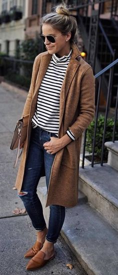 Tan cardigan over blue and white striped top with jeans.
