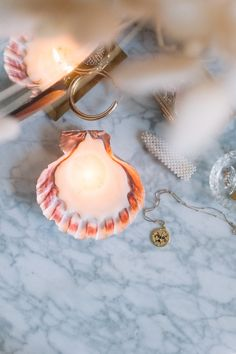 Loving candles has to be my favourite cliche, and today, I'm taking the styled element even further with this shell candle.