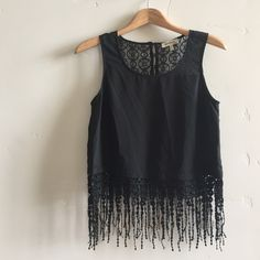 | NWOT Monteau Top Brand new without tags beautiful onyx sleeveless cropped top with crocheted fringe and lace accents.  In new condition. Monteau Tops