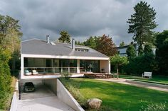 Located in Bussum, Amsterdam, this casual home design may look like your average abode from the front, but let us assure you, it is anything but! The rear Garage Exterior, Car Garage, Modern Villa Design, Street House, Garage Design, Stone Houses, Dream House Plans, Facade House, Home Design Plans