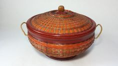 Very unique and wonderful asian basket. Great for serving dips and other food. Just find a glass bowl that fits inside! How fun is that!  You can use this basket in any room of your home to store things. In very nice condition for its age with nice colors.  Size: 8 1/4 Round x 6 High  Inside edge: 7 5/8 round