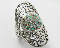 Egyptian ring. Sterling silver ring. Silver ring. Opal ring. Wide ring. Opal silver ring. Silver opal ring. Opal jewelry. Egyptian jewelry   ☀About the Ring:  The ring is made of solid sterling silver 925 Egyptian design decorated with two lab made Opal stones.  ☀ Shipping Info:  All rings are packaged and shipped in a beautiful gift box. It takes about 1-2 weeks to make the ring. The package is sent via international registered air mail that takes 7-30 days to arrive. You can upgrade the…