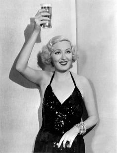 Hollywood, California April 19, 1933.Former Ziegfeld showgirl and sometimes actress Peggy Hopkins Joyce raises a glass of beer to celebrate the end of Prohibition.