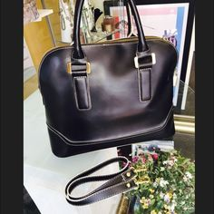 Black satchel Vegan leather black handbag, one low visible ink mark in third picture other wise in good used condition with removable shoulder straps. Ivanka Trump Bags Satchels