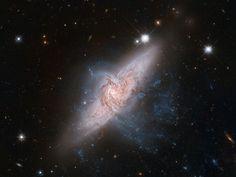 NASA - A Chance Alignment Between Galaxies
