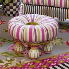 Surrender to the lighthearted romance of an afternoon spent sipping lemonade under a striped awning. A sweet silhouette and hand-painted feet in picnic-perfect shades make the Summerhouse Tuffet our very own version of a summer daydream come true. Outfitted in a rayon/linen blend of colored stripes and diamond-patterned fabrics.