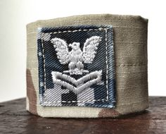 Tan desert camouflage bracelet made from donated Navy uniform with blue rank patch. Benefits military nonprofit by ValorBands on Etsy