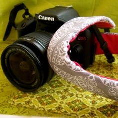 A great camera strap slip cover than can easily be changed with seasons and to fit your personal style. So easy to make!