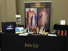 Team JMJ at the New Evangelization Summit. Divine Mercy Rosary Flameless Candles shown on right are a hit! Perfect for private meditation, hospitals and seniors homes.