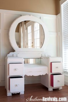 Southern Revivals: A 1940s Vanity Dresser & Mirror Revival { removed veneer and gave a white chalk paint finish to this vanity, and painted the inside of the drawers pink! }