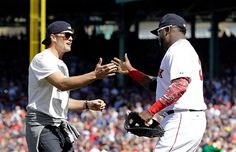 Description of . New England Patriots quarterback Tom Brady, left, greets Boston Red Sox's David Ortiz after throwing the ceremonial first pitch prior to the home opener baseball game between the Boston Red Sox and the Washington Nationals at Fenway Park in Boston, Monday, April 13, 2015. (AP Photo/Elise Amendola)