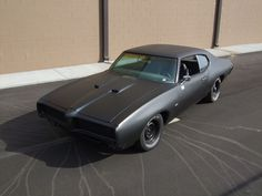 '69 Pontiac GTO in matte black. Purely mean looking!
