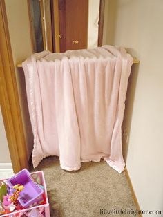 blanket-covered baby gate in hallway--instant play tent