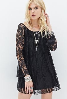 Get your long necklaces and booties ready! This flared shift dress, featuring a gorgeous lace overlay, is an ideal pairing for your favorite autumn accessories. The long bell sleeves add a little retro flair, while the elegant boat neckline creates a free-spirited silhouette for some bohemian charm.