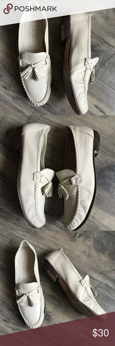 Cole Haan Leather Loafers Leather loafers with a fun tassel. They're more of a cream color. The soles are fairly worn but can be resoled. On the back of the right foot, there is a slight blue mark. Cole Haan Shoes Flats & Loafers