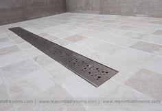OTL linear wet room drain with mosaic tiled floor