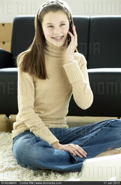 Teenage Girl Using Cell Phone - stock photo. Tags: amazing, barefoot, bare sole, bootcut, cardigan, cellphone, feet, female, flared, girl, jeans, jumper, look women, pullover, sweater, teenager, turtleneck, босиком, джинсы-клёш
