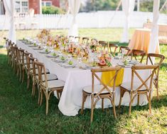 This sweet backyard wedding with a romantic flower aisle ceremony has us walking on sunshine with its bright yellow, green and pink color palette, pear-filled reception decor and wildflower cake. Whimsical design details abound from start to finish, so head to Ruffled now to check it out!
