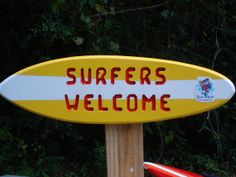 Surf board wall hanger