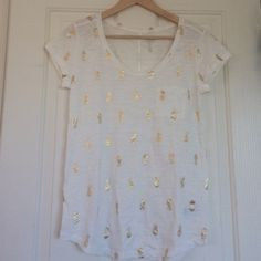 NWT White & Gold Pineapple Small Tee by GAP Darling Summer T-shirt brand new, lightweight white with gold sparkling pineapples, a scoop neck and fun seam down the back. Chest measurement is approximately 32 inches. GAP Tops Tees - Short Sleeve